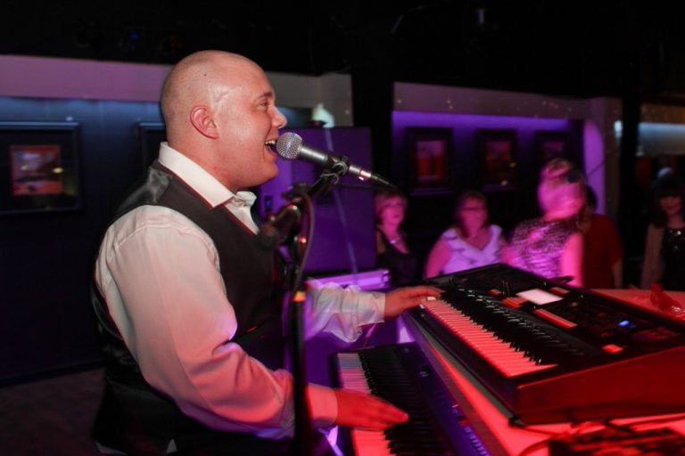 A piano party wedding for a well loved local business man