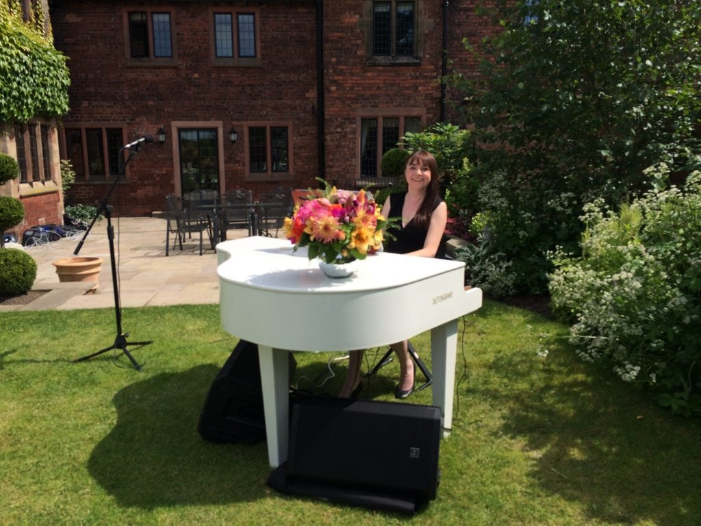 Liz Hendry wedding pianist performing for a wedding ceremony outside in the ground of Colshaw hall