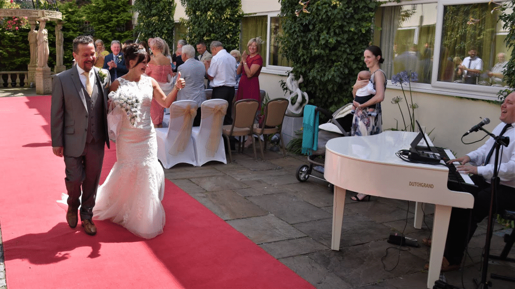 Mark the piano guy playing an outside wedding ceremony for mr and Mrs Clarke