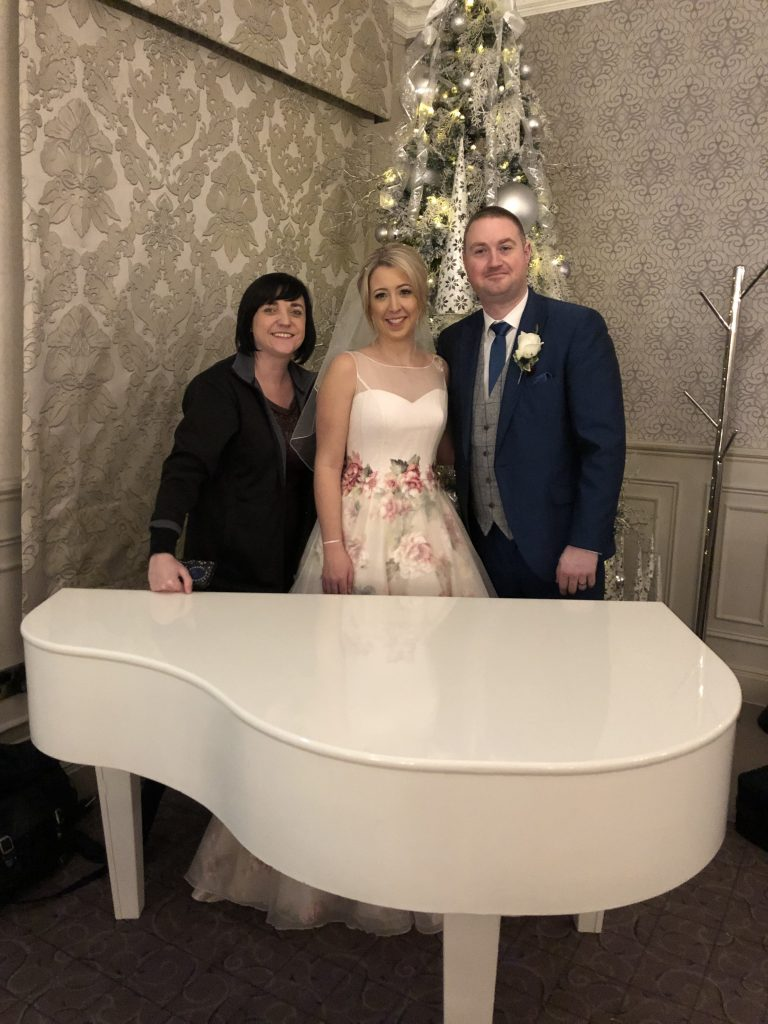 Liz Hendry Cheshire Wedding Pianist, with a bride and groom from Mottram Hall