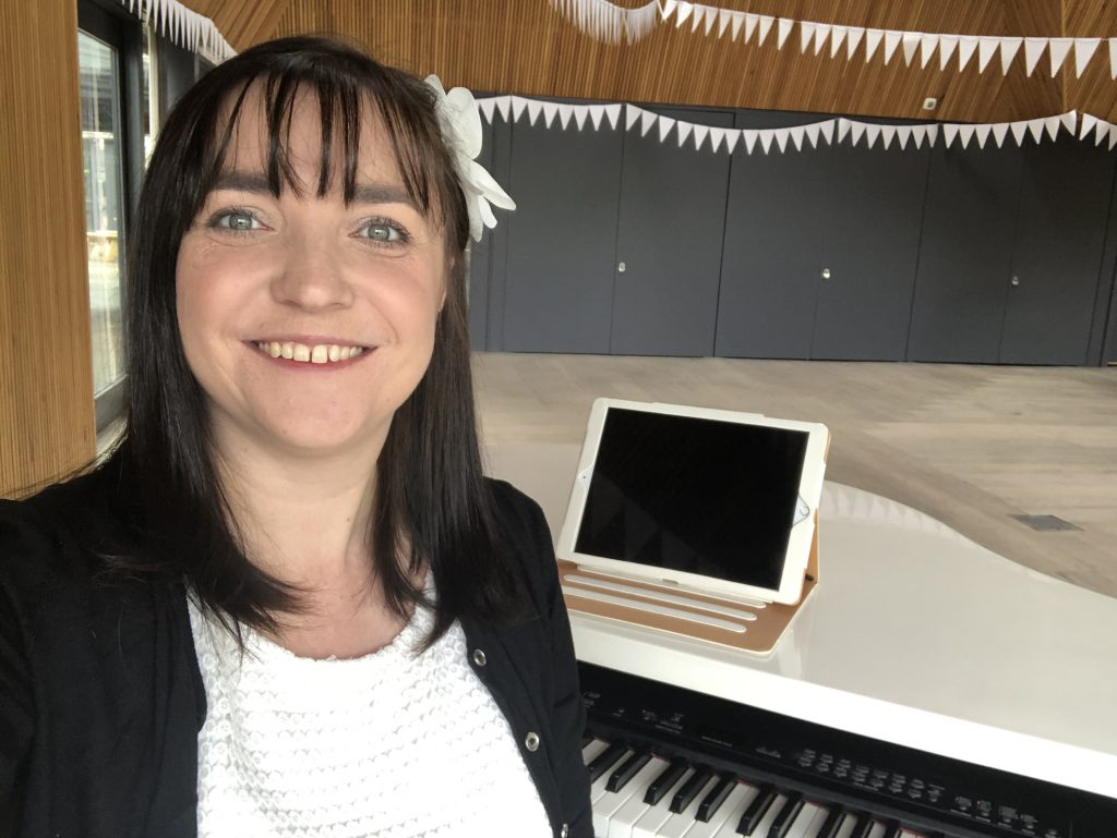 Liz Hendry set up with her white baby grand piano ready to provide wedding music for a Brockholes wedding
